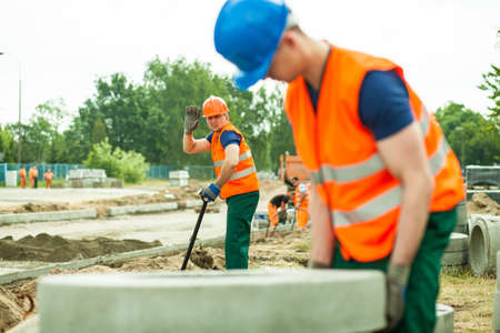 labourers: Young physical labourers working at road construction