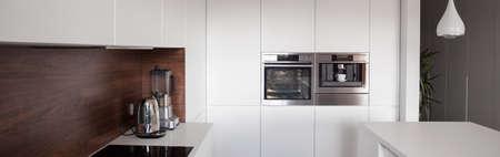 luxury apartment: Luxury white kitchen in exclusive apartment, panorama