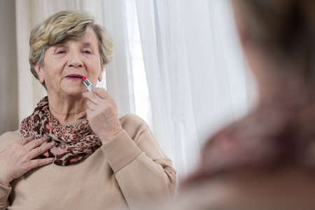 red lip: Elderly womans daily routine before going out