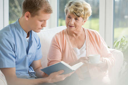 Happy older woman spending time with young man