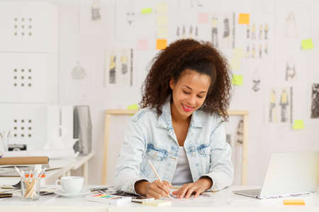 graphic design: Photo of professional female designer drawing new project Stock Photo