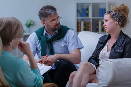 Picture of young pair with problem during psychotherapy