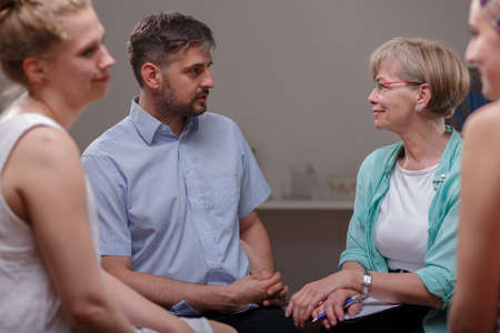 patients: Photo of patients talking with psychologist about their problems Stock Photo