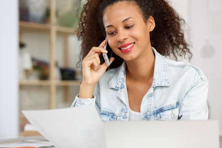 working on laptop: Photo of fashion designer calling her business partner