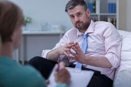 depressed man: Image of depressed man listening his therapist advice
