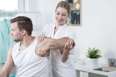 physical test: Image of beauty female physiotherapist at work