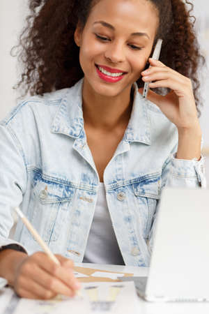 mobilephone: Picture of smiling self-employed woman talking on mobilephone