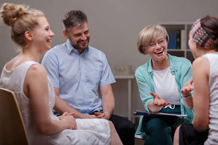 support group: Picture of support group during meeting with professional therapist Stock Photo