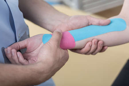 taping: Close-up of kinesiology taping after wrist injury