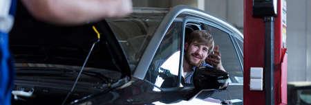shop skill: Customer is checking his car after repair