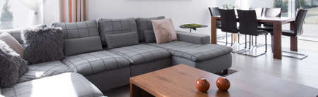 clean home: Tasteful and beautiful couch with coffee table Stock Photo