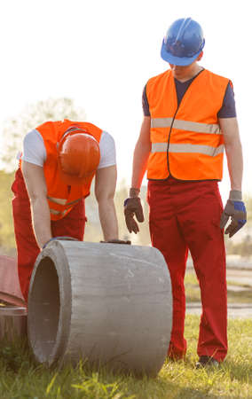 tired: Image of tired construction workers working outdoor
