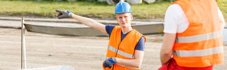security man: Outdoor labourers working on a construction site Stock Photo
