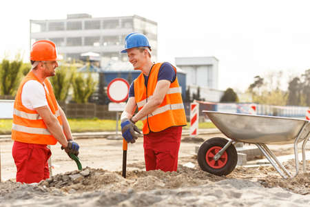 roadwork: Smiling builders working at the road construction Stock Photo