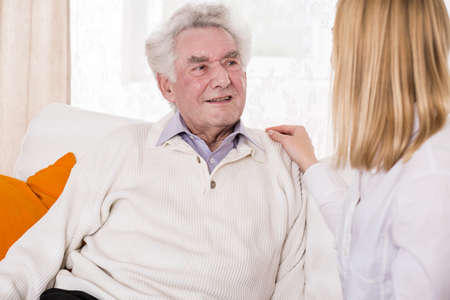 assisting: Image of daughter talking with senior father
