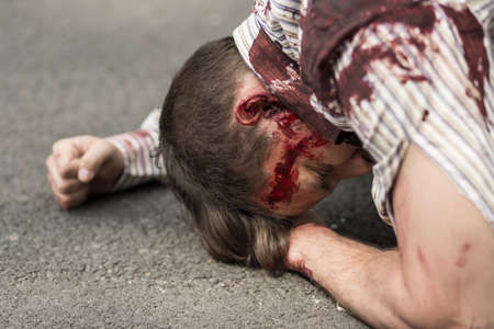 accident dead: Horizontal view of casualty of terrorist attack Stock Photo
