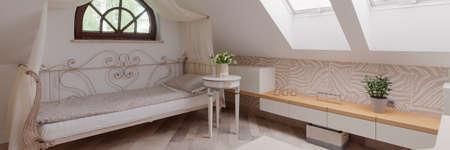 tasteful: Tasteful bedroom on the attic of the house