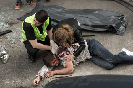 Corpse of young man lying on the street