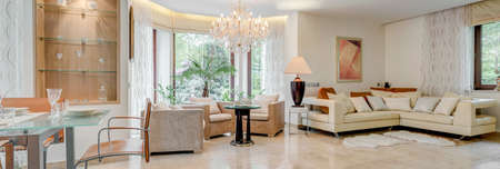 Living room with big and exclusive chandelier