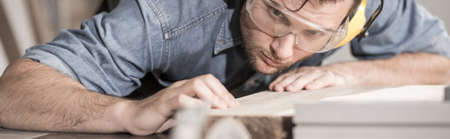 precise: Young carpenter is very neat and precise Stock Photo