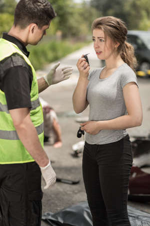 drunk girl: Scared driver talking with policeman at accident area
