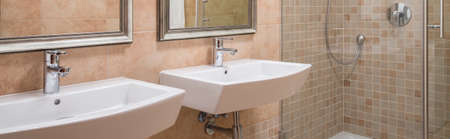 washbasins: Modern bathroom interior with washbasins and shower