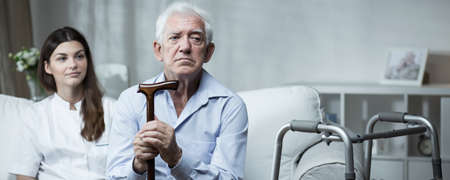 Despair senior man living in rest home Standard-Bild