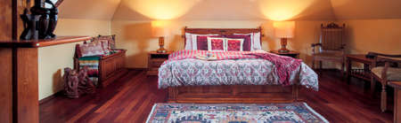 bedroom design: Panorama of stylish bedroom in colonial design