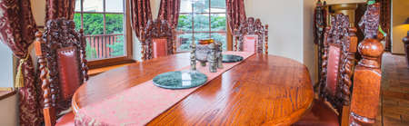 antique table: Wooden antique table in luxury dining room Stock Photo