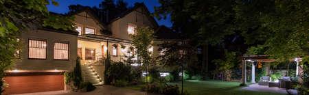 Luxurious modern home with patio in garden Foto de archivo