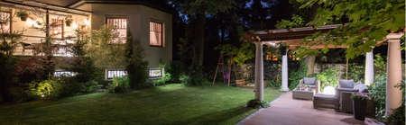 patio: Luxury villa with patio in garden at night