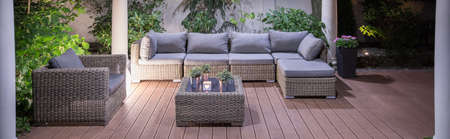 Lovely furniture in luxury villa backyard patio Stock Photo