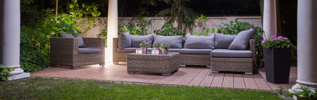 Panoramic view of garden patio with furniture Stock Photo