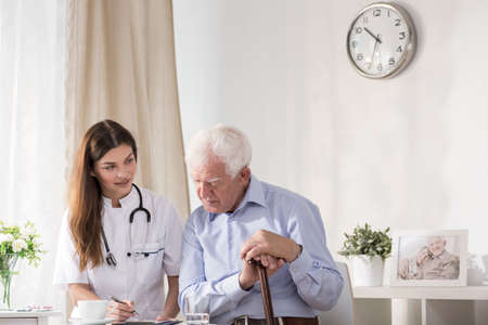 care at home: Doctor talking with senior man about his illness
