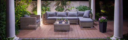 patio chairs: Lovely garden patio with cozy wicker furniture
