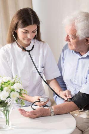 hypertension: Senior man with hypertension having measured blood pressure Stock Photo
