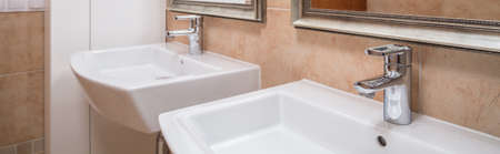 washbasins: Two modern washbasins in contemporary caramel bathroom