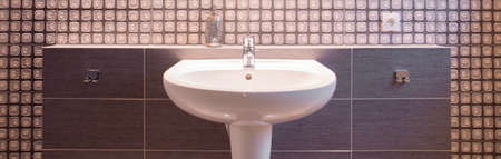 luxurious: White ceramic sink in modern furnished luxurious bathroom