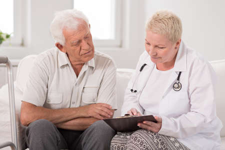 senescence: Image of elderly male patient during medical interview Stock Photo
