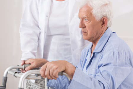 senescence: Close up of sad elderly patient with walking problem Stock Photo