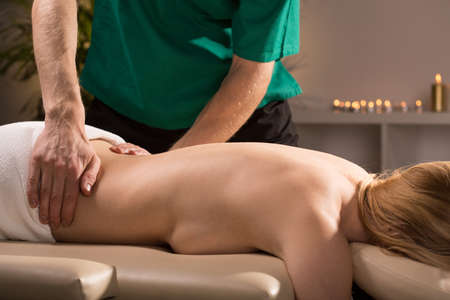 muscle tension: Young woman having spa treatment in expensive hotel Stock Photo