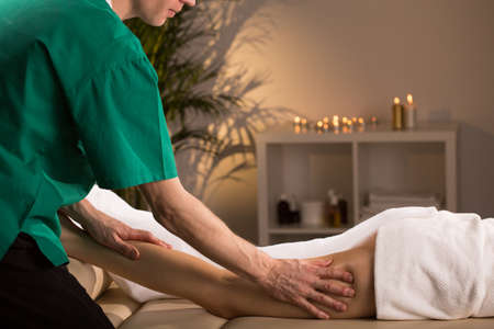 smoothing: Woman having smoothing and anti-cellulite legs massage