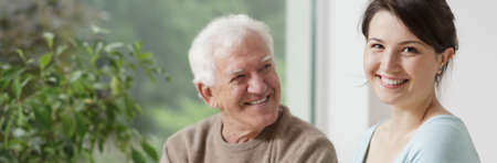 Smiling grandfather and caring granddaughter - panorama