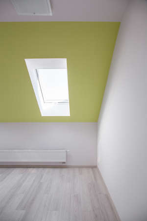 attic room: Skylight on ceiling of attic room in modern house Stock Photo