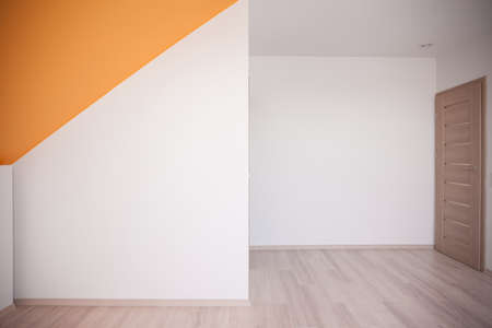 minimalist apartment: Walls painted white with orange color accent on the ceiling