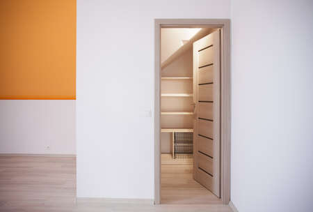 commodious: Storage idea for attic bedroom closet in home