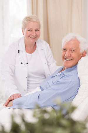 home health care: Photo of smiling male patient of geriatric ward Stock Photo