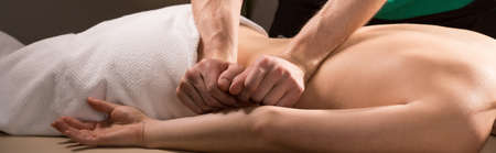 Panoramic photo of therapeutic back massage treatment