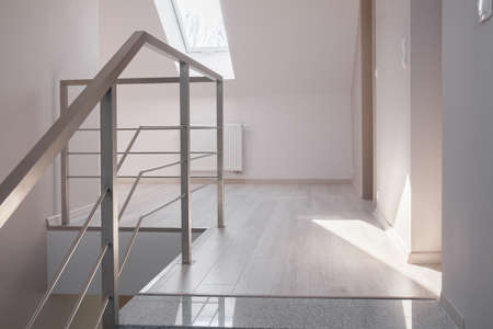 commodious: Steel handrail and marble stairs in luxurious modern house