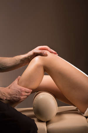 calf pain: Therapeutic massage performed to numb the knee pain